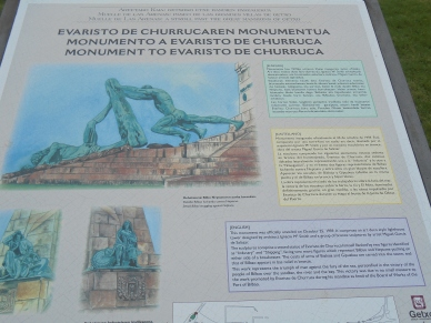 A placard detailing information about the statue in the park