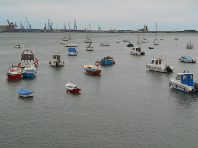 Boats stay afloat in position on the calm waters