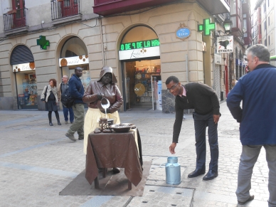 Antoine donating to a local street performer.