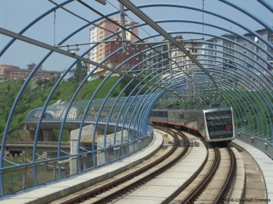 Metro train crossing a bridge